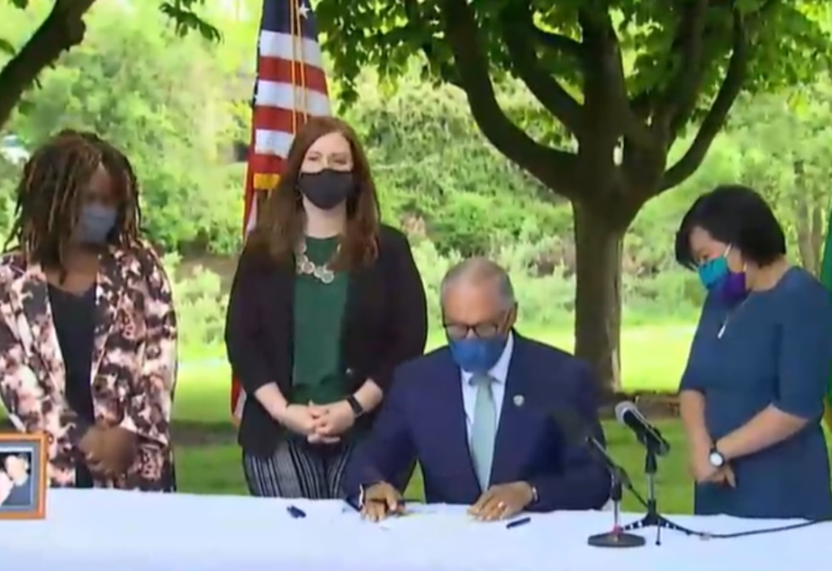caption: Gov. Jay Inslee signed into law a new capital gains tax and an expanded version of the state's Working Families Tax Exemption which has never before been funded.