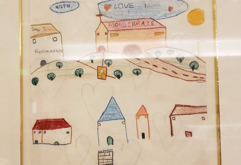 caption: A drawing from a migrant child hangs in this courtroom in South King County.