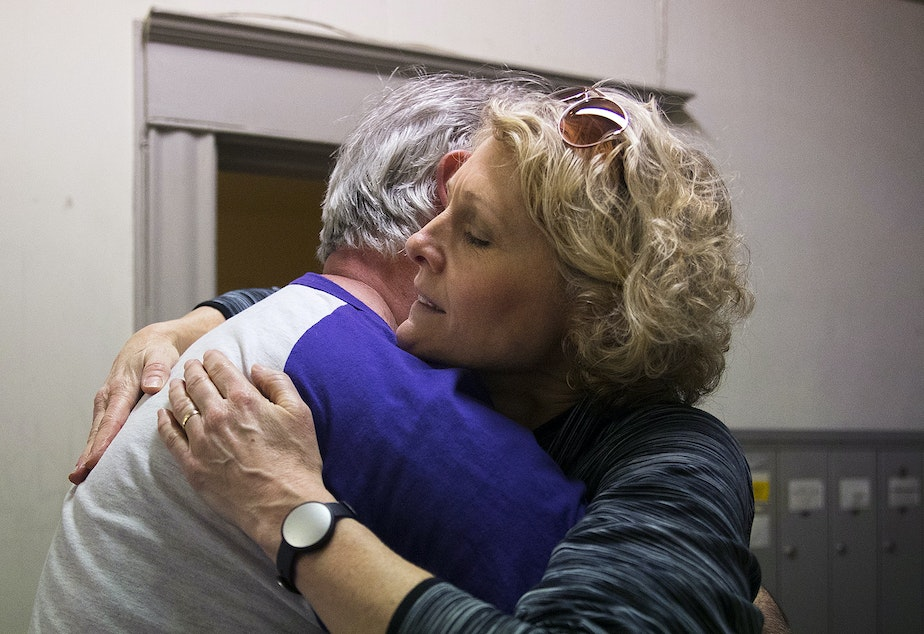 Jerri Clark, right, hugs Todd Crooks, before packing up her son Calvin's apartment on Friday, March 22, 2019, in Seattle.