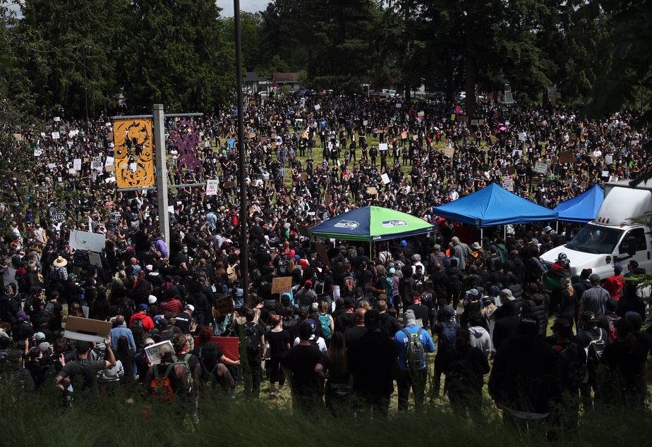 caption: Thousands of people gather in Othello Park in South Seattle ahead of a march on Sunday, June 7, 2020.