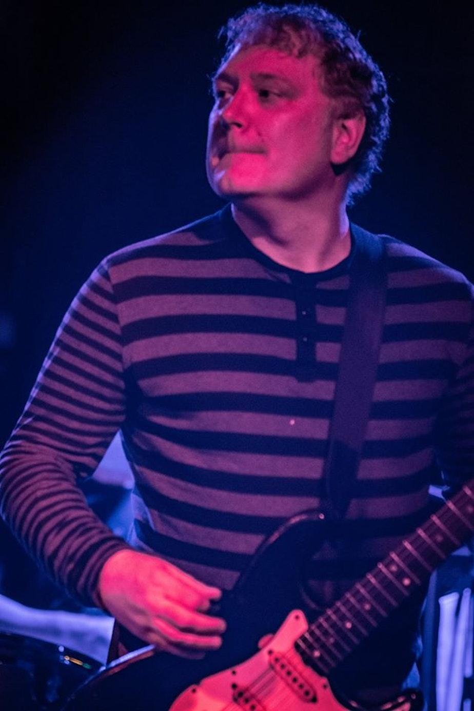 caption: James Burdyshaw on guitar.