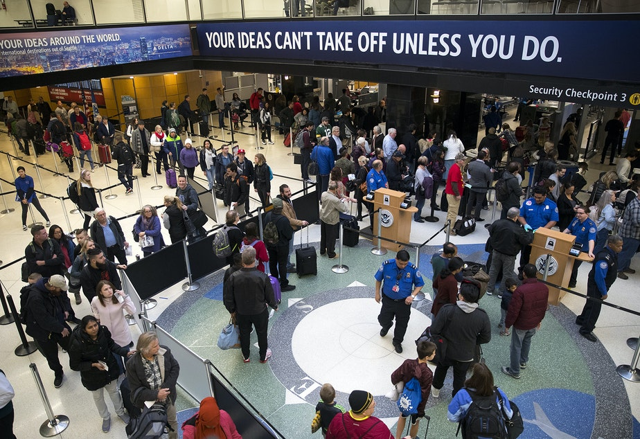 A line forms at security checkpoint 3 on Wednesday, December 13, 2017, at Seattle-Tacoma International Airport.