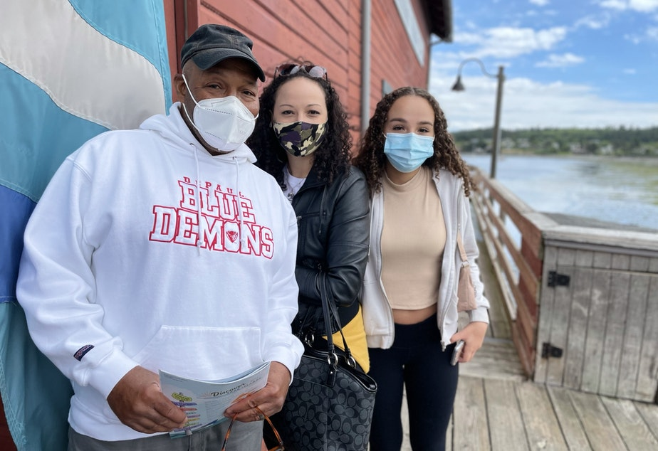 caption: Tourists on Coupeville's historic wharf, just off Front Street. They are Darren Humes of Florida, with his daughters Marie Mucciante and London Flowers from Illinois.