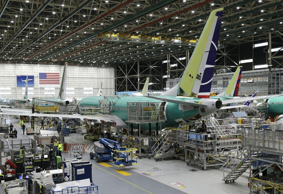 caption: FILE - In this March 27, 2019, file photo people work on the Boeing 737 MAX 8 assembly line during a brief media tour in Boeing's 737 assembly facility in Renton, Washington