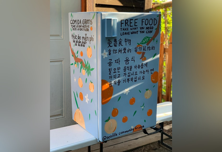 caption: A Seattle Community Fridge, freshly painted and about to be placed at the Danny Woo Community Garden.