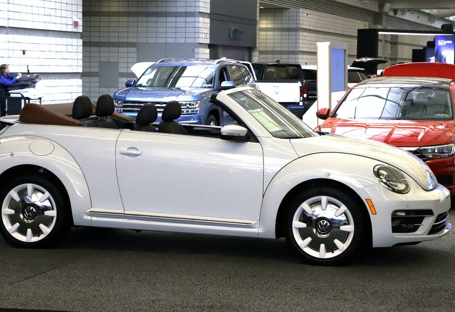 caption: A 2019 Volkswagen Beetle convertible on display at the Pittsburgh International Auto Show in February.