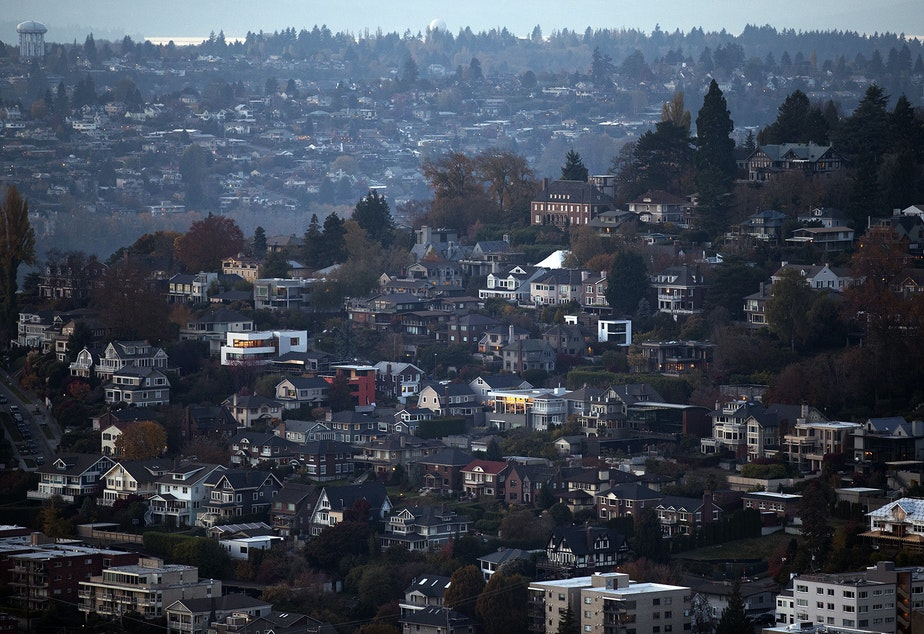 caption: Homes in Queen Anne enjoy more tree cover than other areas of Seattle.
