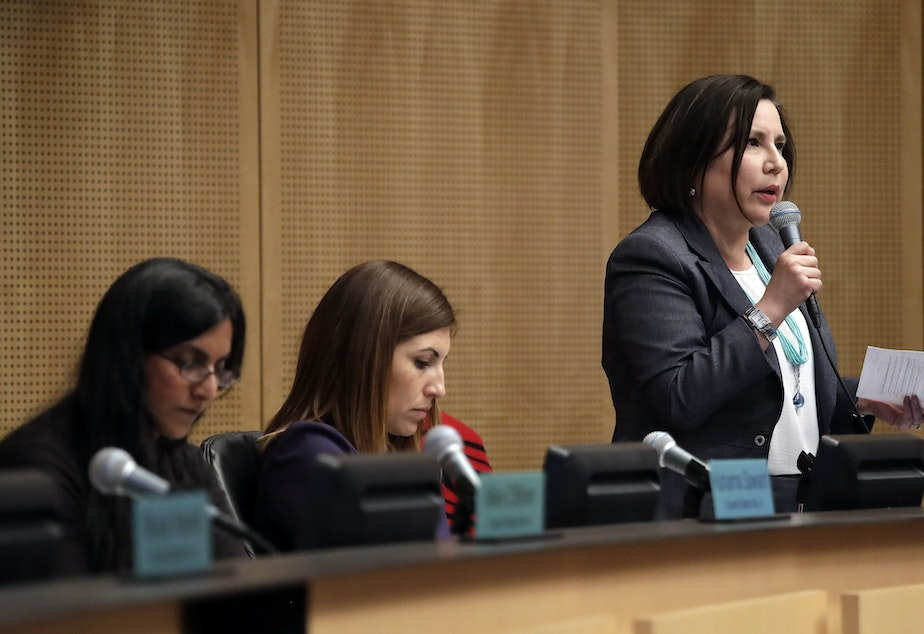 caption: Seattle City Council member Debora Juarez, right, speaks as council members Kshama Sawant, left, and Teresa Mosqueda sit nearby before the council voted to approve a tax on large businesses such as Amazon and Starbucks to fight homelessness, Monday, May 14, 2018, in Seattle.