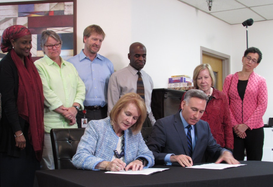 At a Salvation Army shelter, Seattle Mayor Jenny Durkan and King County Executive Dow Constantine signed an agreement pledging to align their homelessness funding process.