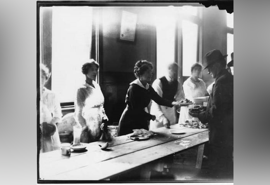 "From Wikimedia Commons: ""The strike committee set up soup kitchens and distributed as many as 30,000 meals each day. In the photo, a woman serves a plate of food to a striking worker."""
