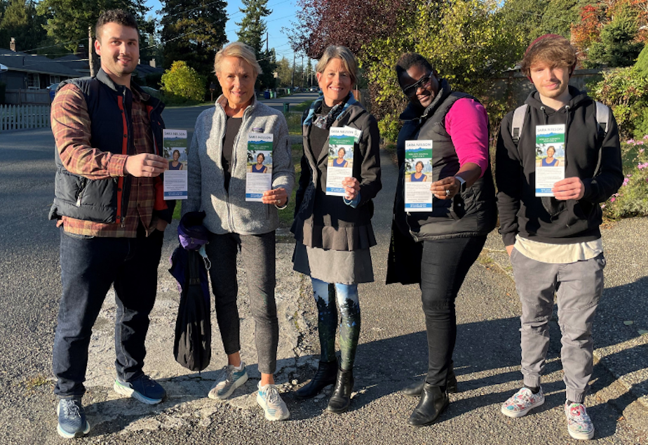 caption: Sara Nelson campaigns for Seattle City Council Position 9 with volunteers ahead of the November 2021 election.