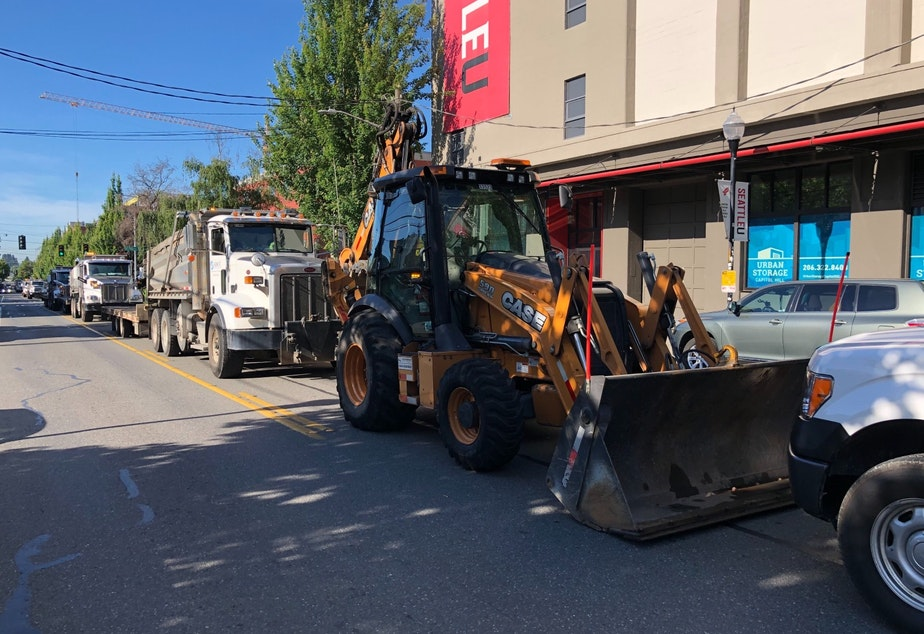 caption: SDOT equipment, after driving right up to barriers at the CHOP, eventually retreated to this point a few blocks east.