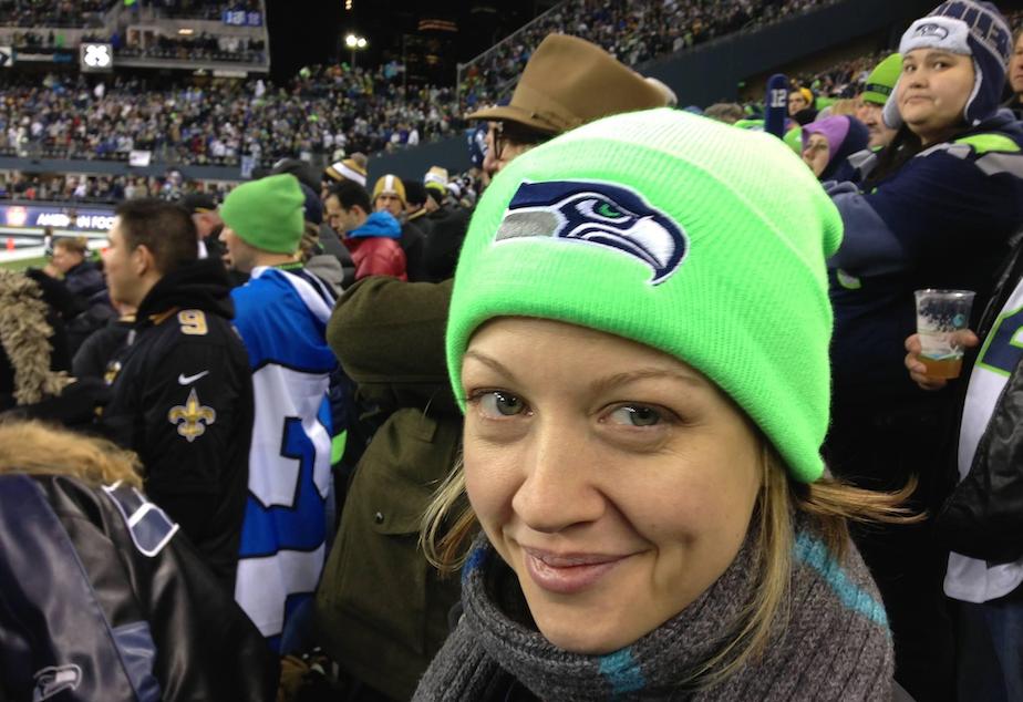 caption: Andrea Thomas Churna attending a sports game.