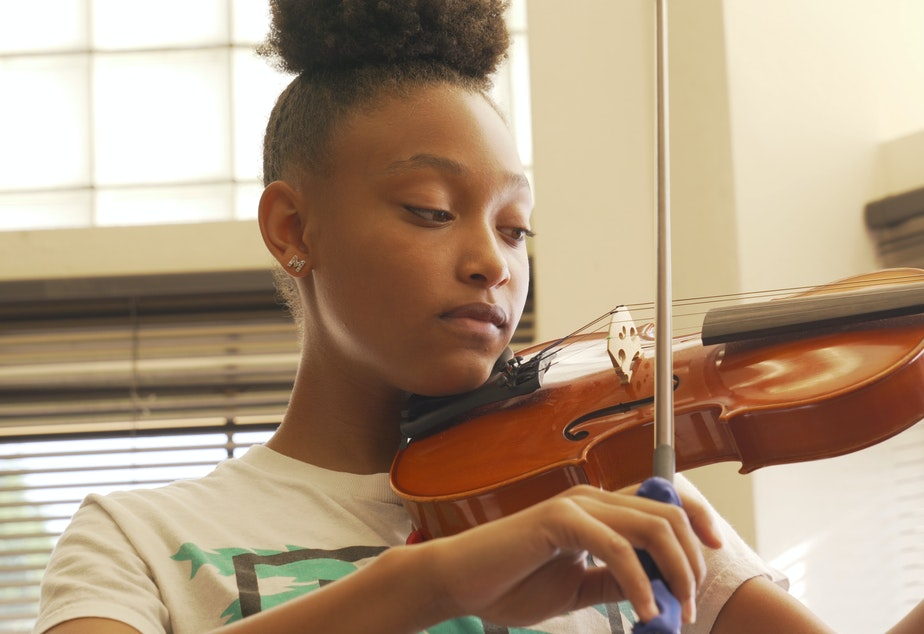 caption: Key to Change violin student