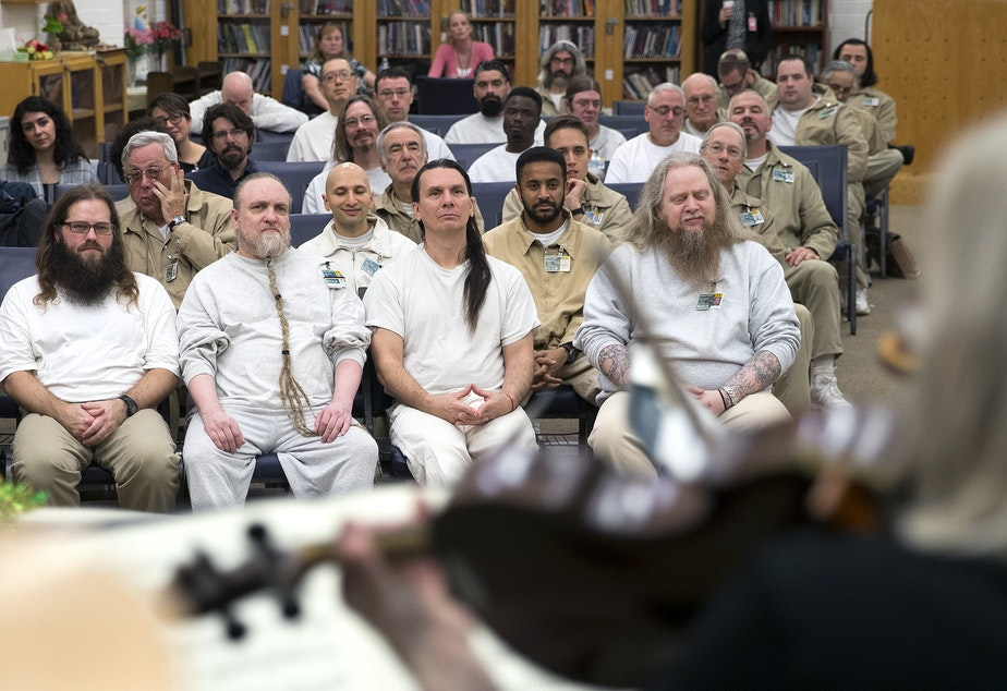 caption: Incarcerated individuals listen to members of the Seattle Symphony perform on Wednesday, November 29, 2018, at the Monroe Correctional Facility. Tap or click on the first image to see more.