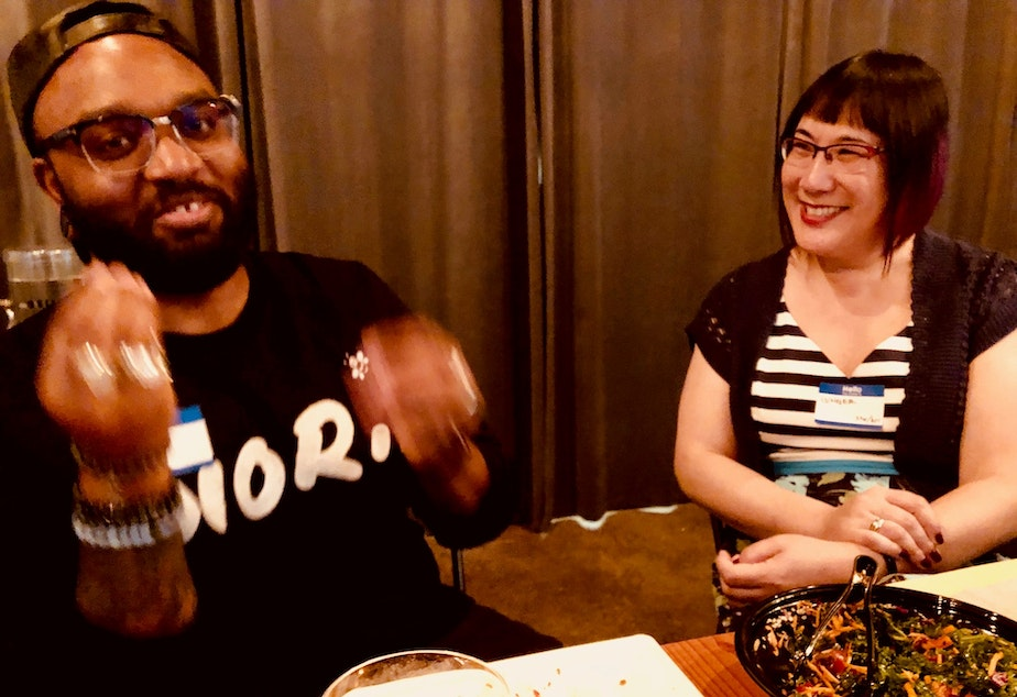 Club members Timothy Bardlavens and Ginger Chien talk at KUOW's first LGBTQ-themed Curiosity Club dinner on June 7, 2019 at The Cloud Room in Seattle.