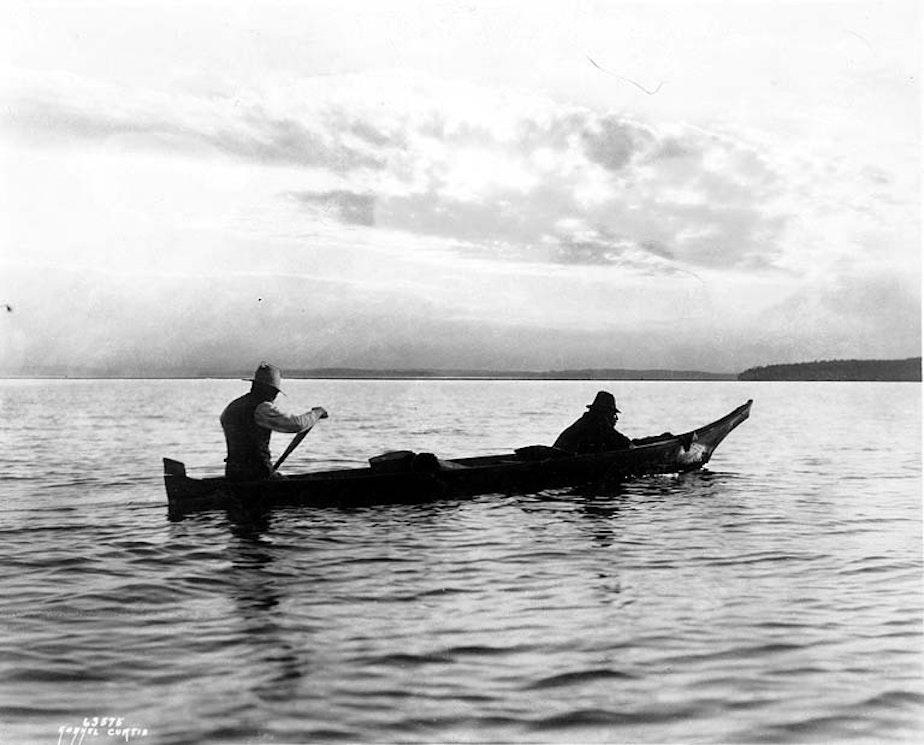caption: Lummi men trolling for salmon from canoe, near Bellingham, Washington, ca. 1900.