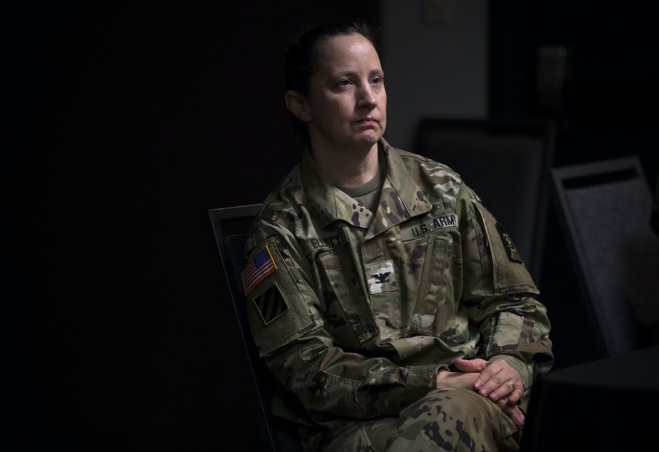 """caption: Col. Laura Elliott, commander of the 62nd Medical Brigade stationed at Joint Base Lewis-McChord attends a press conference on Tuesday, March 31, 2020, at the CenturyLink Field Event Center in Seattle. """"We could be here sixty days; we could be here six months,"""" said Col. Elliott."""