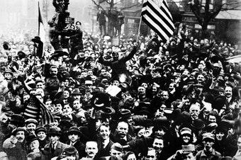 Americans join the celebration on the Grand Boulevard on Armistice Day for World War I in Paris, France, Nov. 11, 1918. (AP Photo)