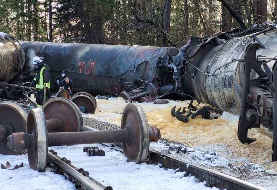 caption: Officials inspect the aftermath of an oil train fire in Custer, Washington, on Dec. 24.