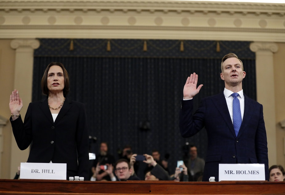 caption: Former White House national security aide Fiona Hill, left, and David Holmes, a U.S. diplomat in Ukraine, are sworn in to testify before the House Intelligence Committee on Capitol Hill in Washington, Thursday, Nov. 21, 2019, during a public impeachment hearing of President Donald Trump's efforts to tie U.S. aid for Ukraine to investigations of his political opponents.