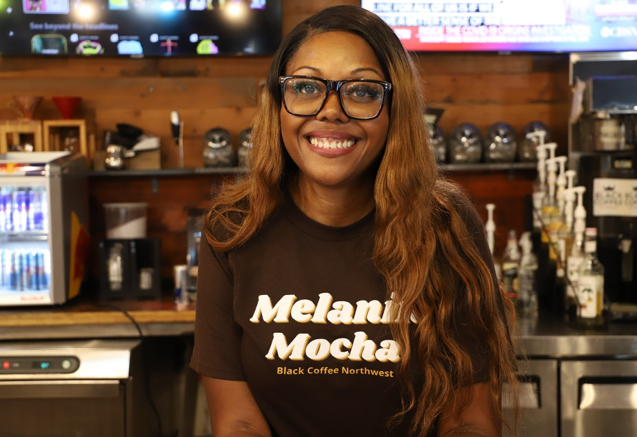 caption: Darnesha Weary, co-owner of Black Coffee Northwest in Shoreline, WA, poses for a portrait, July 1, 2021.