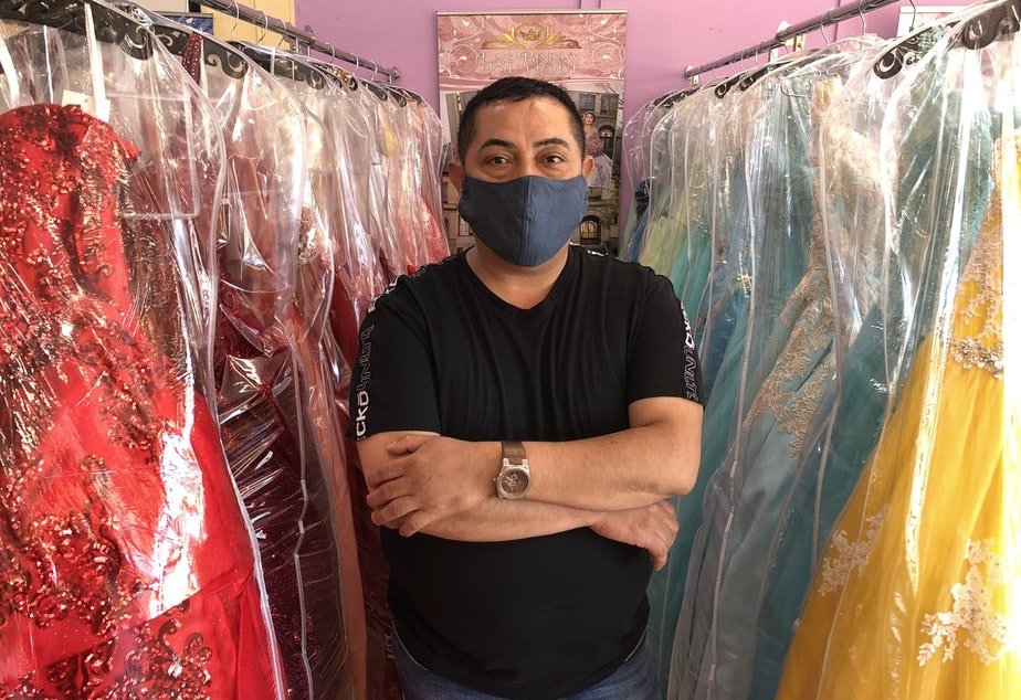 caption: Ramiro Alvarez of Las Brisa's Boutique in White Center. Many of his customers have stopped making payments on wedding and quinceañera dresses, because those ceremonies aren't happening during the pandemic.