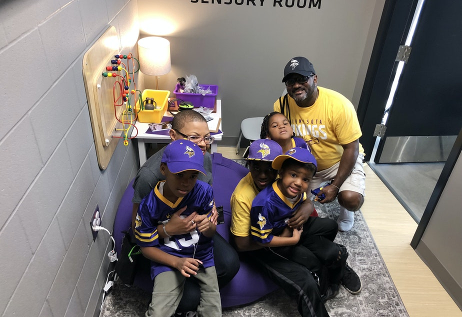 caption: Sheletta and Shawn Brundidge, alongside their four children, were the first fans to use the sensory room at the Minnesota Vikings' U.S. Bank Stadium. Opened during the August pre-season, the space comes with trained therapists and provides fans, including those with autism, a break from the excitement of the game.