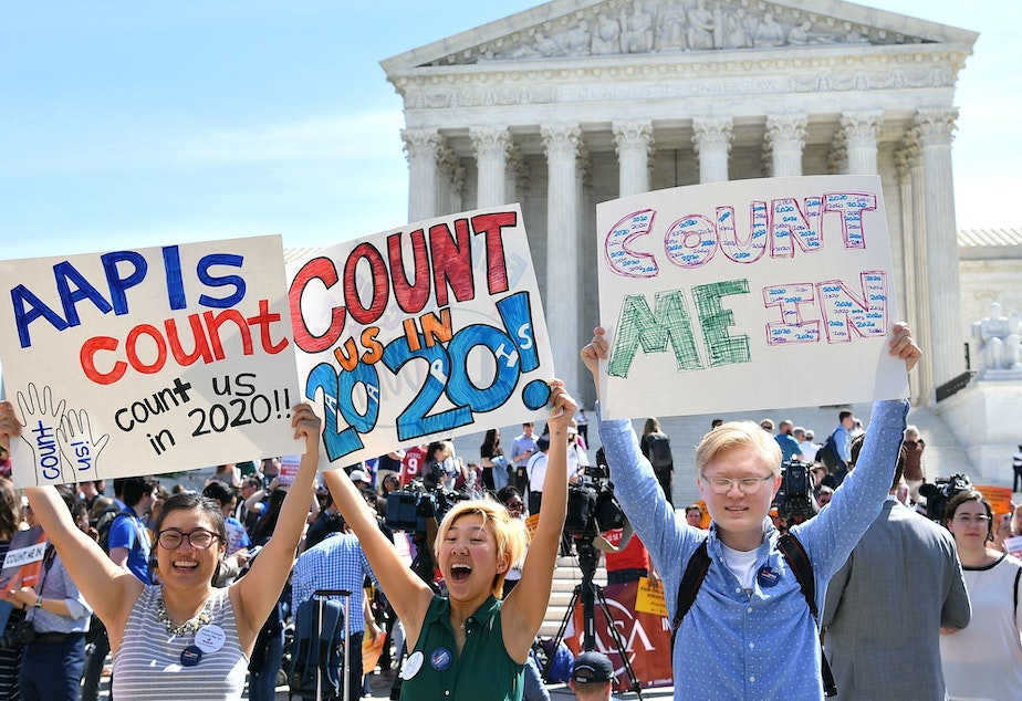 caption: Demonstrators rally outside the U.S. Supreme Court in Washington, D.C., in April to protest the Trump administration's plan to add a citizenship question to forms for the 2020 census.