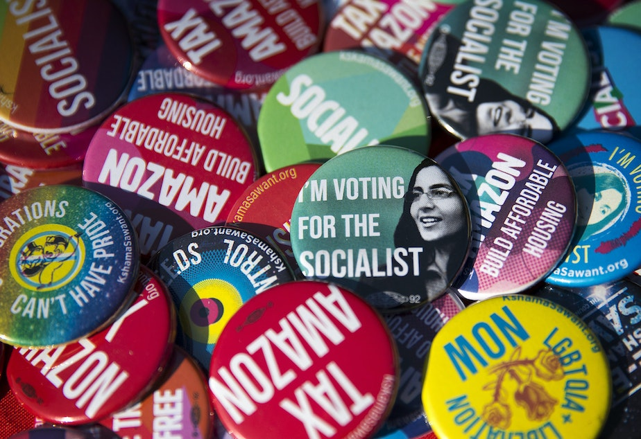 caption: Pins supporting councilmember Kshama Sawant are shown on Sunday, August 4, 2019, at Pratt Park in Seattle.