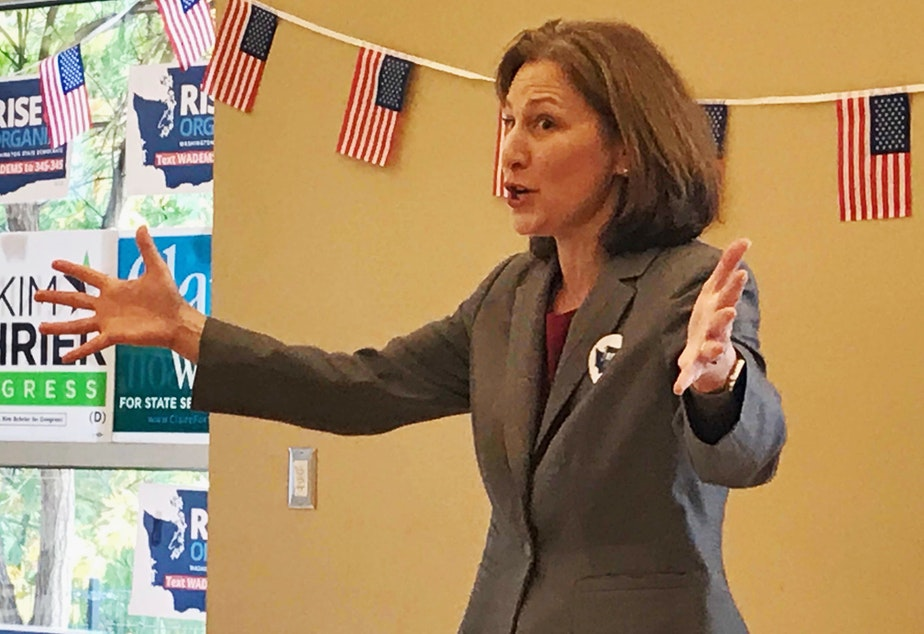 Democrat Kim Schrier speaks to supporters at a community center in Federal Way on Thursday.