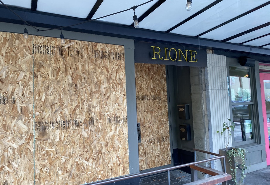 caption: Businesses boarded up windows and doors ahead of the election, Nov. 3, 2020.