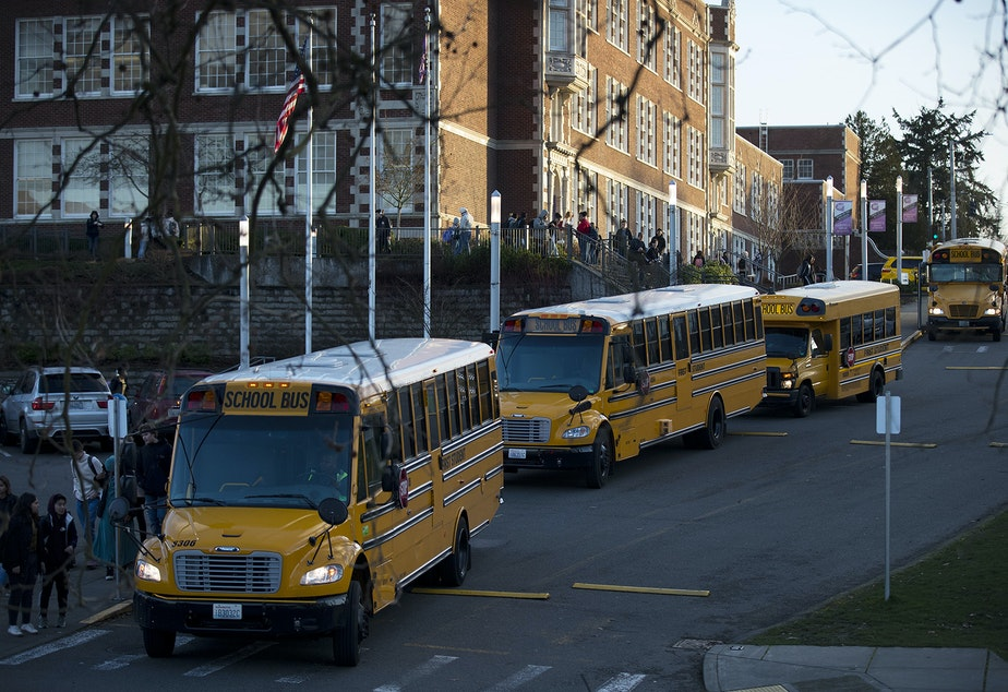 caption: School busses line up at the end of the school day on Monday, January 7, 2019, at Garfield High School in Seattle.