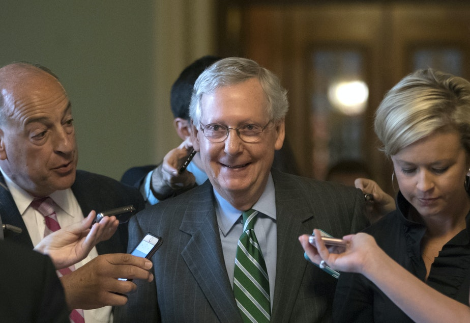 Senate Majority leader Mitch McConnell smiles as he leaves the chamber after announcing the release of the Republicans' health care bill Thursday, June 22, 2017.