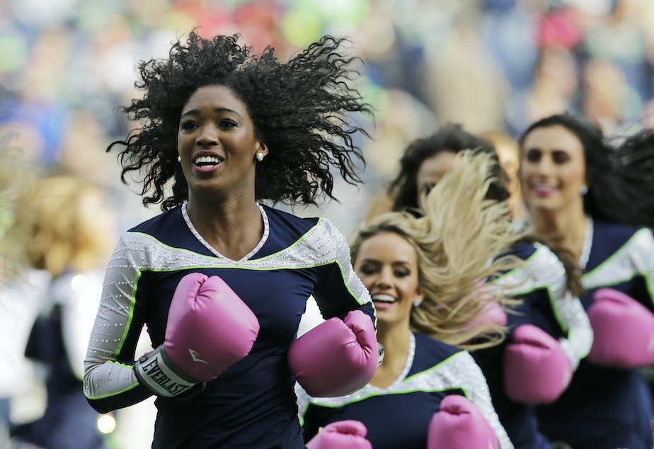 Seattle Seahawks Sea Gals cheerleaders perform during halftime of an NFL football game Sunday, Oct. 29, 2017, in Seattle. The gloves were part of the Seahawks and NFL football's Crucial Catch campaign to support the fight against breast cancer.