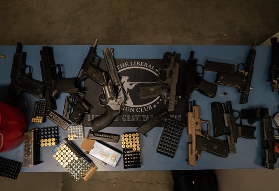 <p>Guns are splayed out at the gun range during The Liberal Gun Club&rsquo;s winter range day on Jan. 26, 2019 in Portland, Ore.</p>