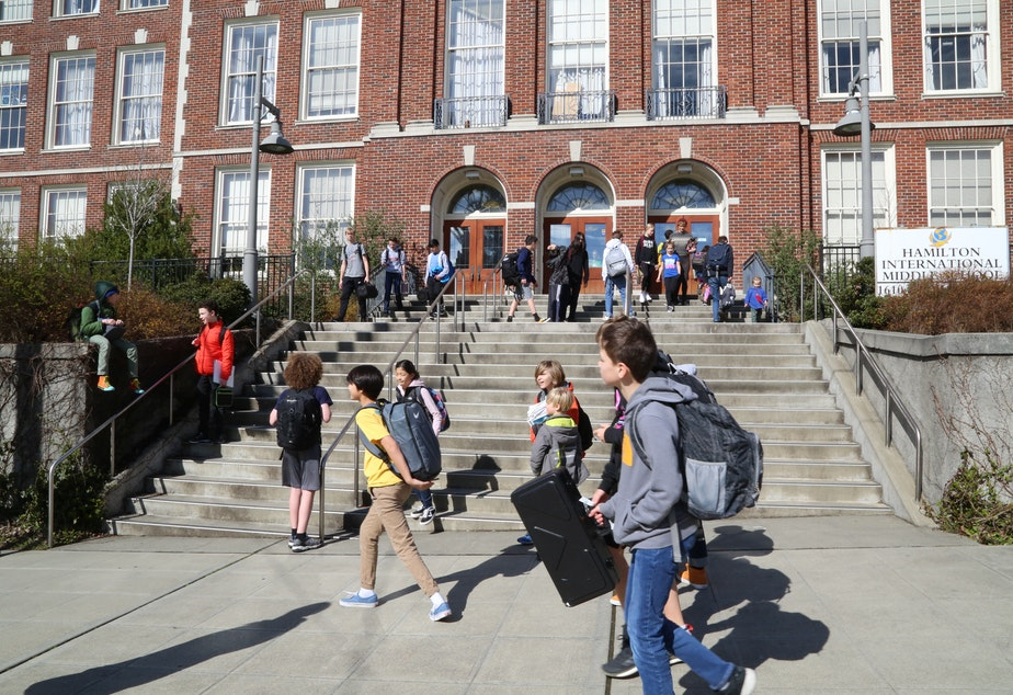 caption: Students leave Hamilton International Middle School on  March, 11, 2020, after Seattle Public Schools decided to close all school buildings in response to the Covid-19 pandemic.