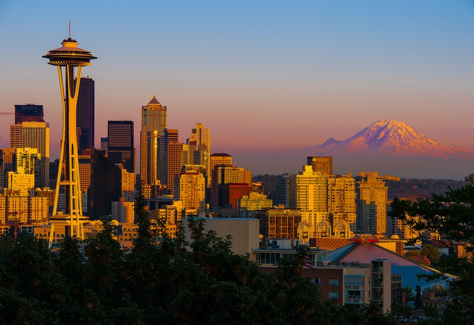 The summer sun sets on Seattle, center of a growing region and state.