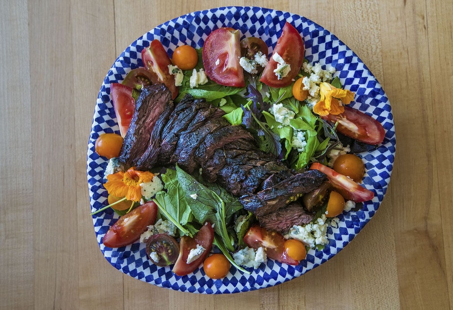 caption: Chef Kathy Gunst's grilled steak salad with blue cheese, tomatoes, and greens. (Jesse Costa/WBUR)