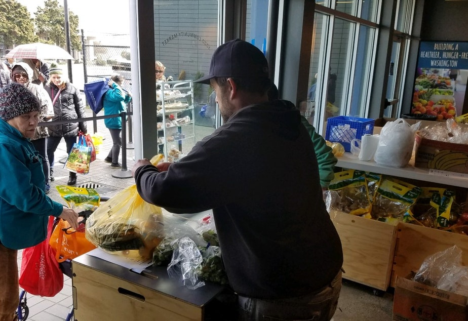 caption: A recent food distribution at Sodo Community Market. Food banks are expecting a big increase in people who need their services, and they are already having a hard time stocking their shelves.