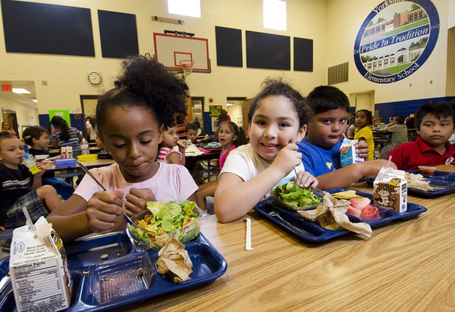 caption: Students try the new school lunch menu at the Yorkshire Elementary School in Manassas, Virginia, Sept. 7, 2012.