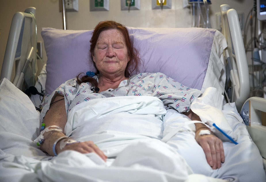 caption: Deborah Judd, 56, a second-grade teacher at Laurelhurst Elementary, becomes emotional while describing the carjacking and shooting that left her injured on Wednesday afternoon, in her hospital room on Thursday, March 28, 2019, at Harborview Medical Center in Seattle.