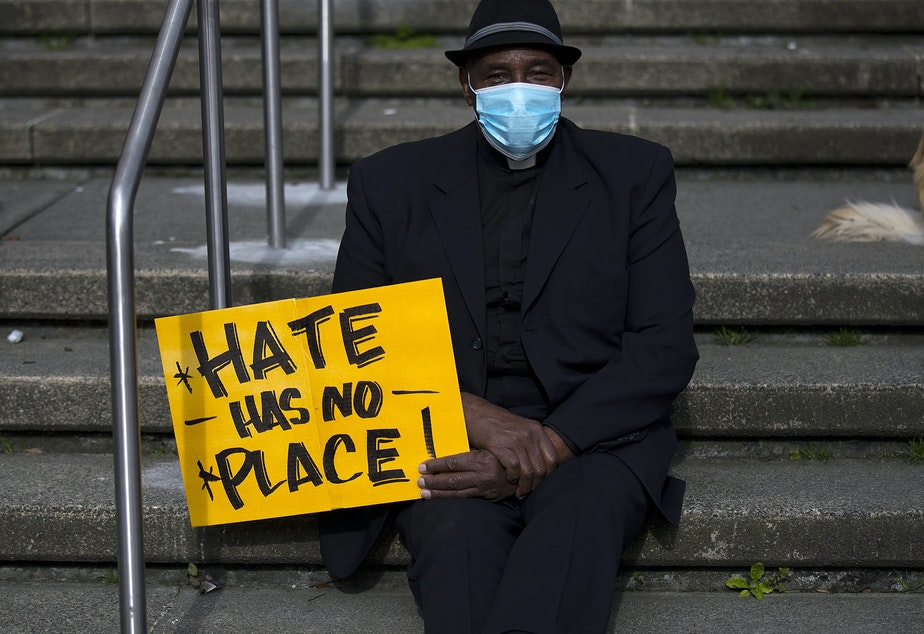 caption: Reverend Wayne Perryman attends the 'We Are Not Silent' rally against anti-Asian hate and violence on Saturday, March 13, 2021, at Hing Hay Park in Seattle. Several days of actions are planned by rally organizers in the Seattle area following recent attacks and violence against Asian American and Pacific Islander communities.