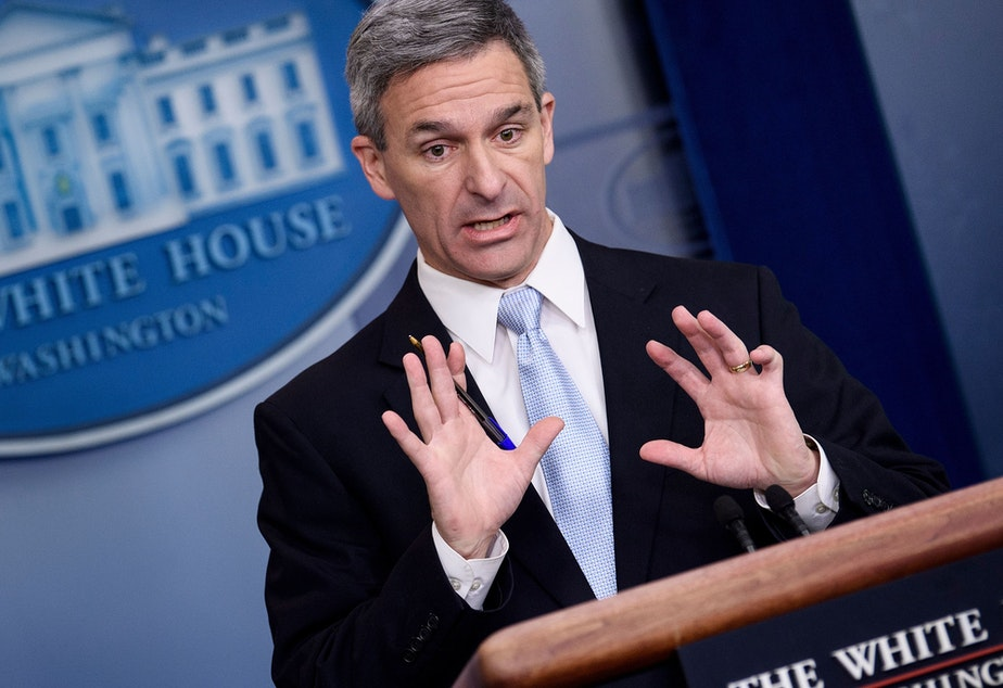 caption: Acting Director of the U.S. Citizenship and Immigration Services Ken Cuccinelli speaks during a briefing at the White House on Monday. Trump administration officials announced new rules that aim to deny permanent residency to migrants who may need to use food stamps, Medicaid and other public benefits.