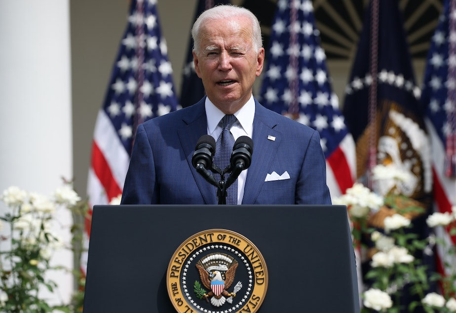 caption: President Biden delivers remarks during an event in the Rose Garden of the White House on Monday.