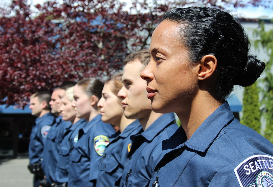 caption: Kimberly Rodriguez, a new recruit for the Seattle Police Department, on her first day at the police academy. That class of 30 recruits included eight women, which was unusual. Most classes have between one and five female recruits.