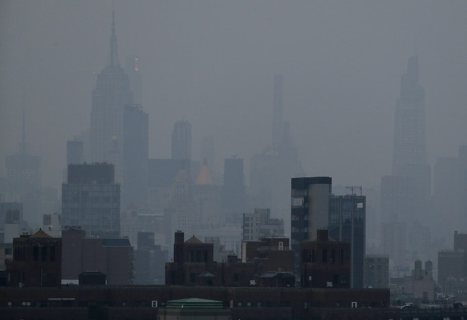 caption: A thick haze hangs over Manhattan on Tuesday. Wildfires in the West, including the Bootleg Fire in Oregon, are creating hazy skies and poor air quality as far away as the East Coast.