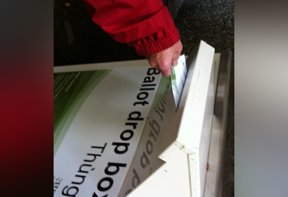 caption: A ballot drop box in Seattle.