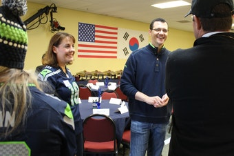 State Sen. Joe Fain (R-Auburn), center, greets supporters at a breakfast campaign event with state Sen. Ann Rivers (R-La Center), left, on Oct. 14, 2018.