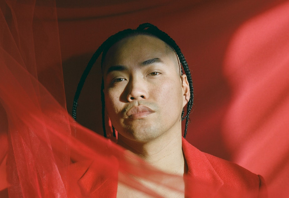 caption: Portrait of Chris from Brooklyn-based photographer Andrew Kung's series The All-American. Kung says this series aims to examine masculinity and what it means to be American within the context the stereotype of the desexualized Asian man.